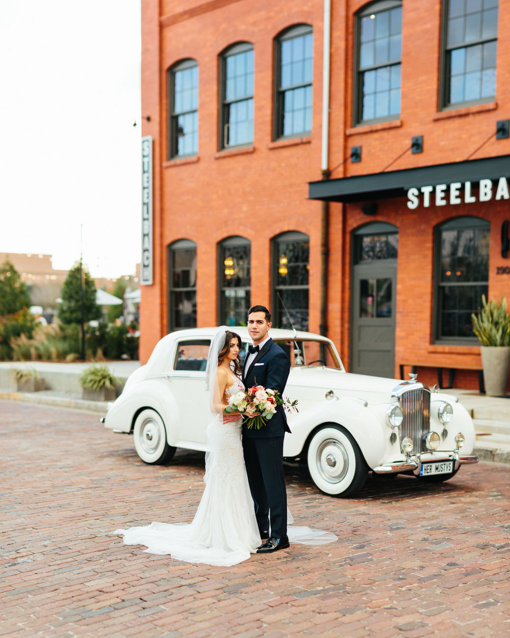 Bride and groom photo with Rolls Royce Armature Works  Wedding