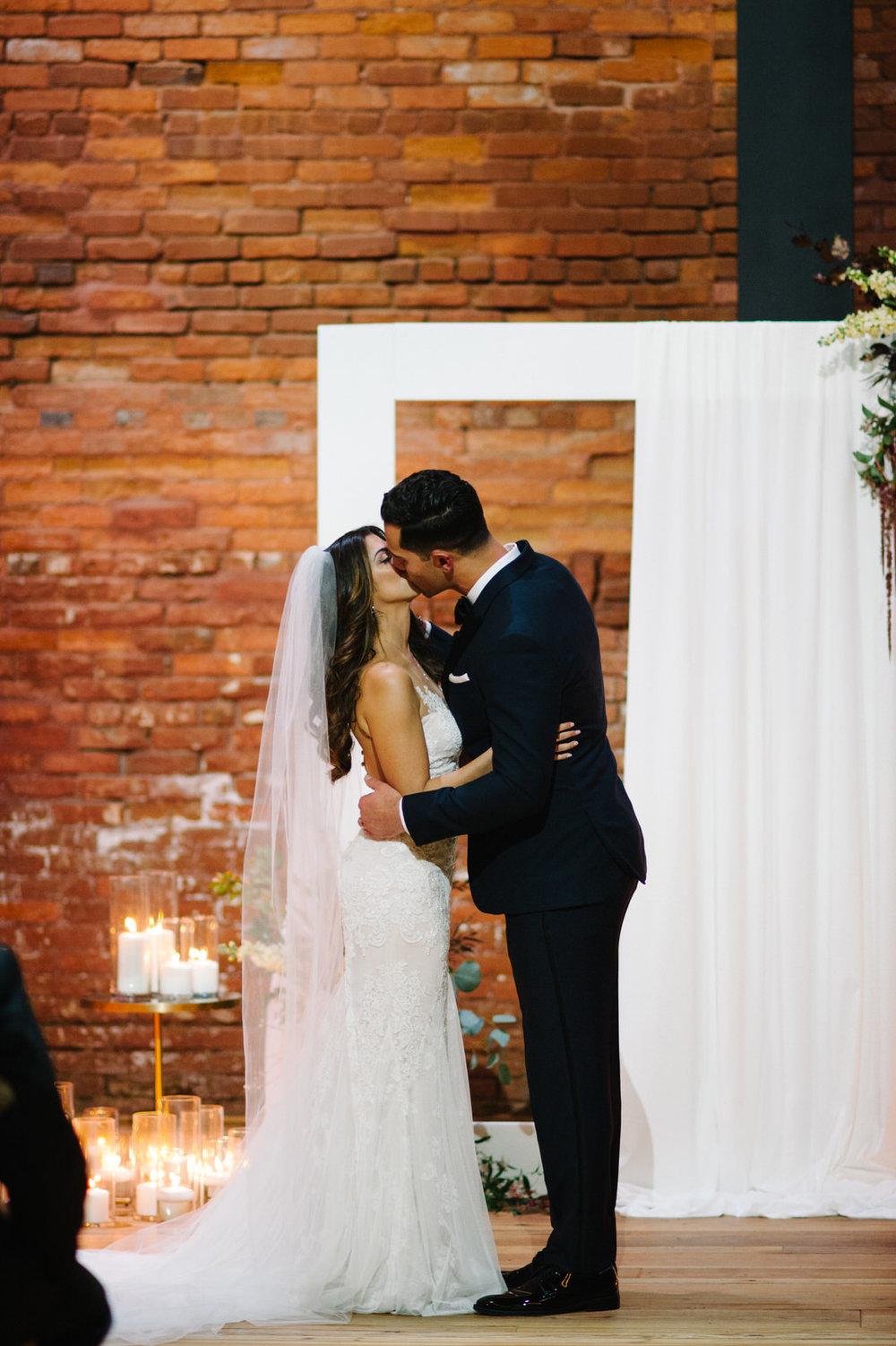 Bride and Groom Wedding Kiss Armature Works Tampa