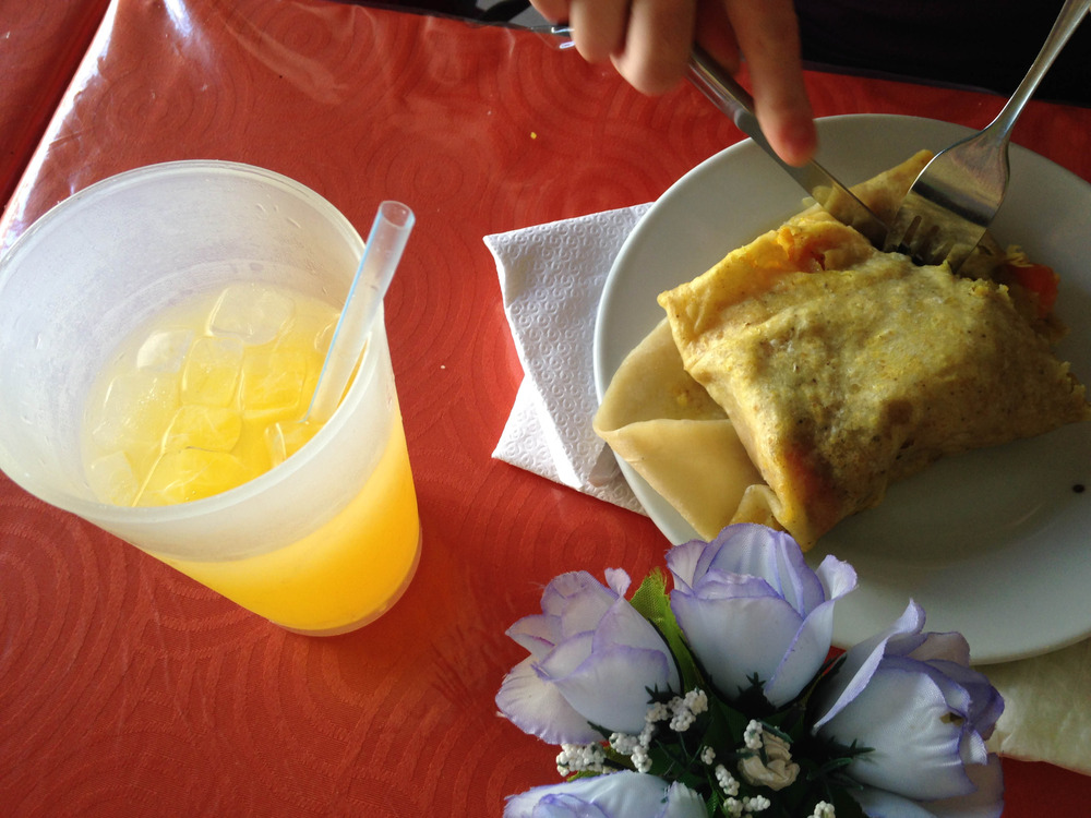 Mauby ( anise flavored drink , made from tree bark ) &  Roti