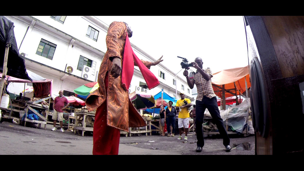 Singer shooting a music video, speakers blasting - Saturday market, Kingstown, SVG - Video Still