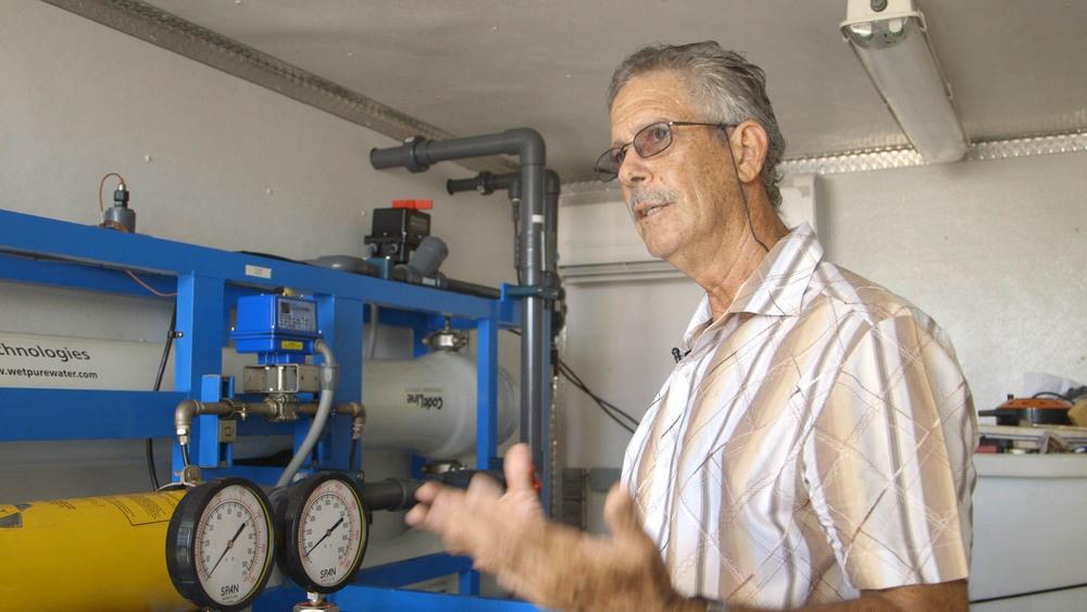 Herman Belmar at the Bequia desalinization plant.