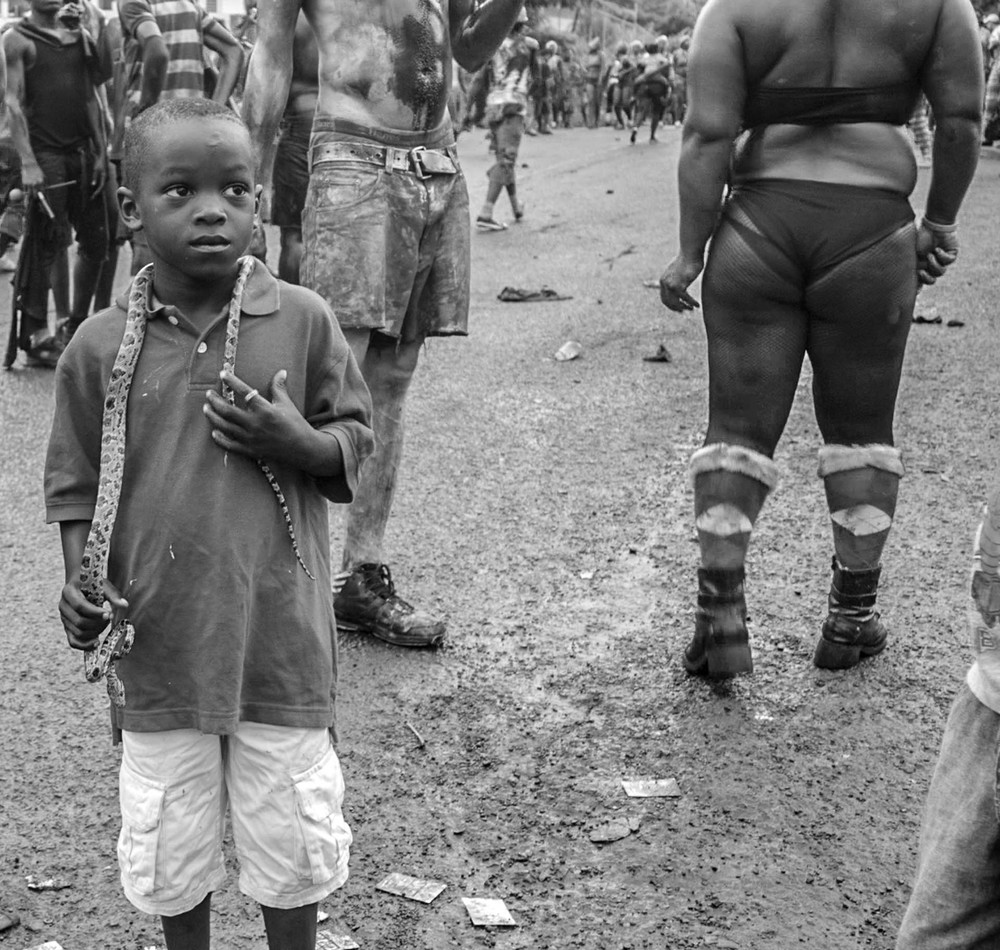 Real snakes used to be more prevalent at J'Ouvert morning. This young Jab Jab player holds the only real snake we saw - a small one.- Video Still, Tom Miller