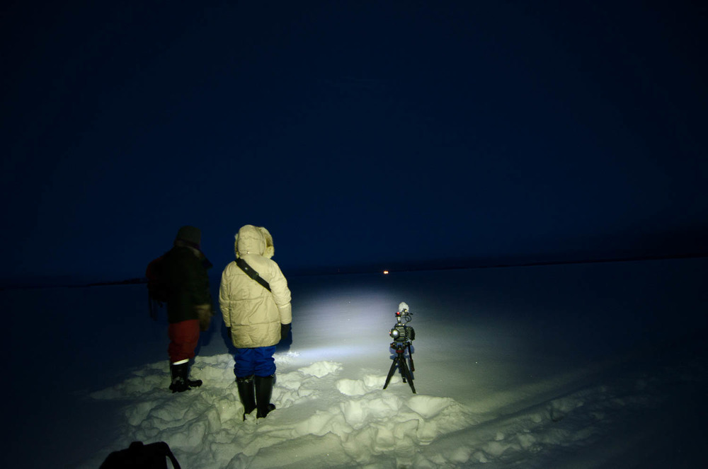 Waiting for the Light - you can see our Skidoo's headlights in the distance