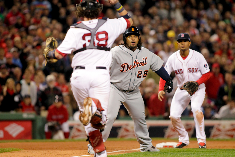 Detroit Tigers runner Prince Fielder (28) is chased down by Boston Red Sox catcher Jarrod Saltalamacchia (39) while third baseman Xander Bogaerts (72) waits at third base after Tigers batter Jhonny Peralta (not pictured ) grounded into a double play in the sixth inning of game six of the ALCS  at Fenway Park in Boston on October 19, 2013.