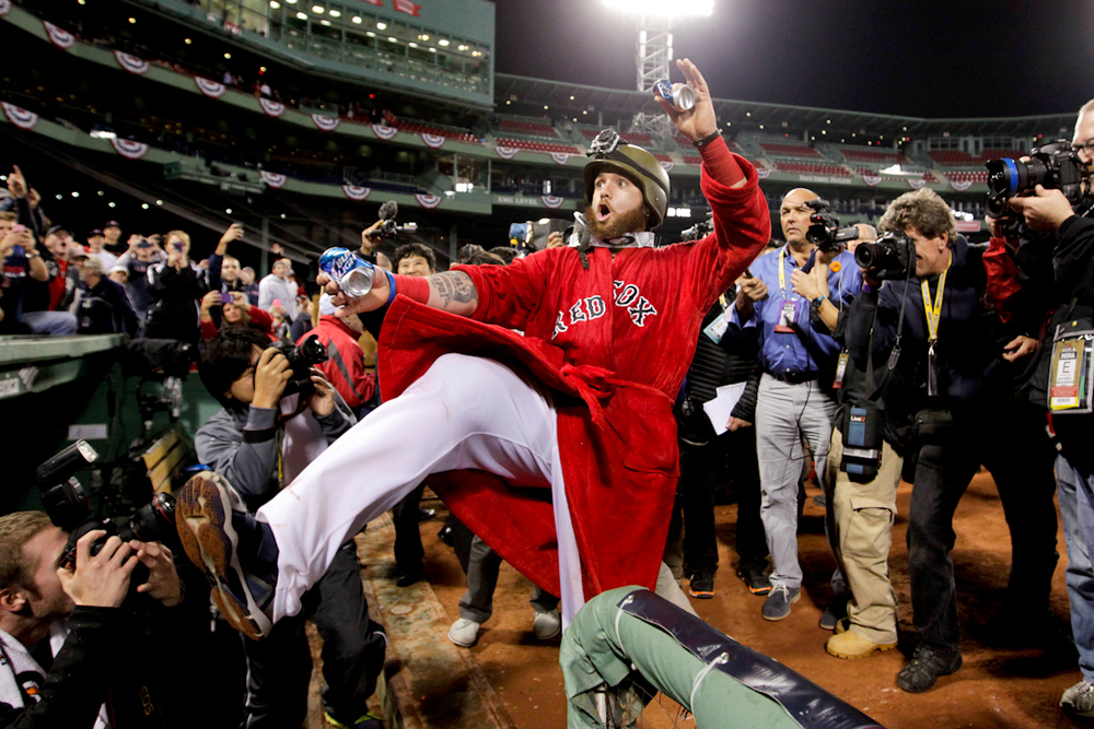 Boston Red Sox left fielder Jonny Gomes celebrates after the Red Sox won the American League Championship after defeating the Detroit Tigers in six games at Fenway Park in Boston on October 19, 2013.