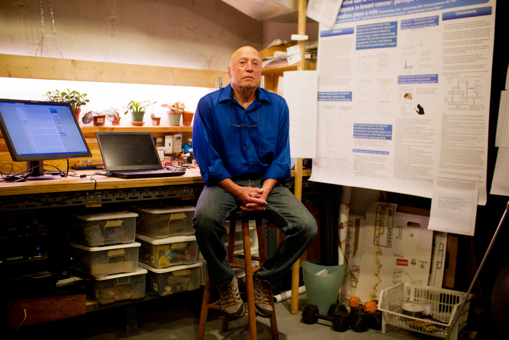 Trumbul, CT -  Cancer survivor Michael Retsky poses for a photo in his basement work station at his home on March 20, 2014. Retsky is among a group of researchers investigating an inexpensive painkiller that may prevent the recurrence of breast cancer but lacks the commercial potential to get a large clinical trial.