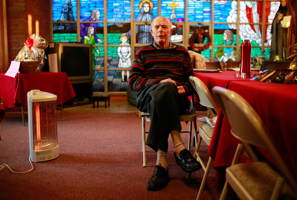 George P. Kelly of Scituate, MA, long time parishioner of St. Frances Xavier Cabrini church, sits for a photo in the vestibule of the church while sitting vigil on Thursday, December 1, 2011 in Scituate, Massachusetts.  Mister Kelly and his fellow parishioners have held an around the clock vigil inside the church since 2004 when the Roman Catholic Archdiocese of Boston announced that St. Frances Cabrini was slated for closure.