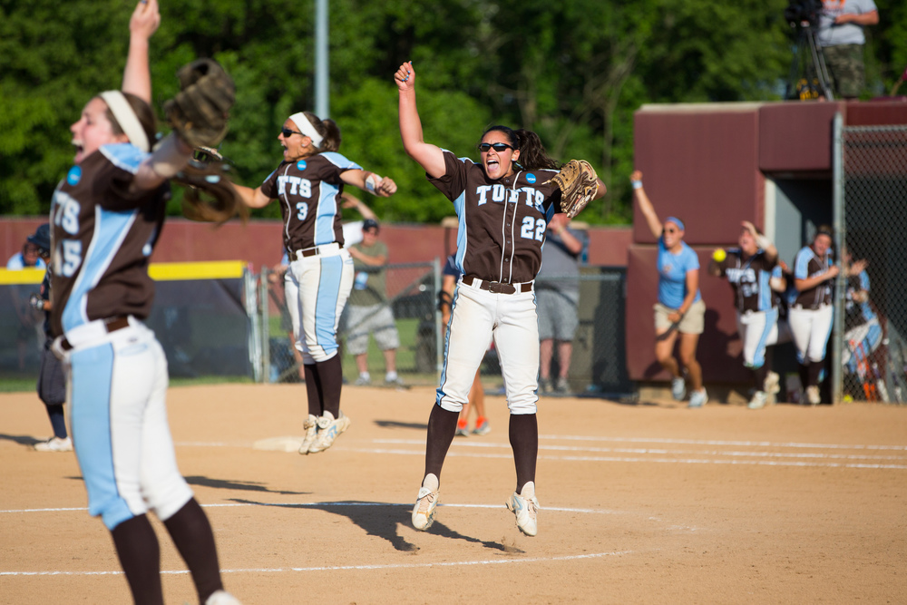 Salem, VA - From left Tufts third baseman Bri Keenan, A15, first baseman Cassie Ruscz, A17, and pitcher Allyson Fournier, E15, celebrate after defeating UT Tyler to clinch their third NCAA Division III Softball Championship at the James I Moyer Sports Complex in Salem, Virginia on Saturday, May 25, 2015. Tufts defeated UT Tyler 7-4.