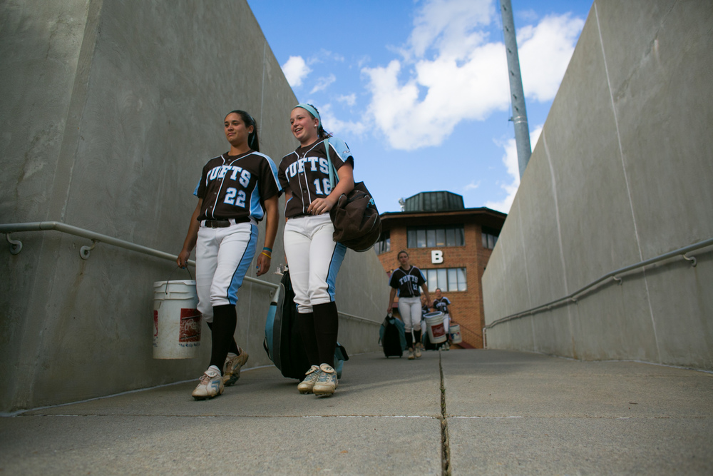 Salem, VA - Tufts pitcher Allyson Fournier, E15, and Tufts catcher and outfielder Sarah Finnigan, A18, head to the field for warm ups prior to the game against Alma in the NCAA Division III Softball World Series at the Moyer Sports Complex on Thursday, May 21, 2015.
