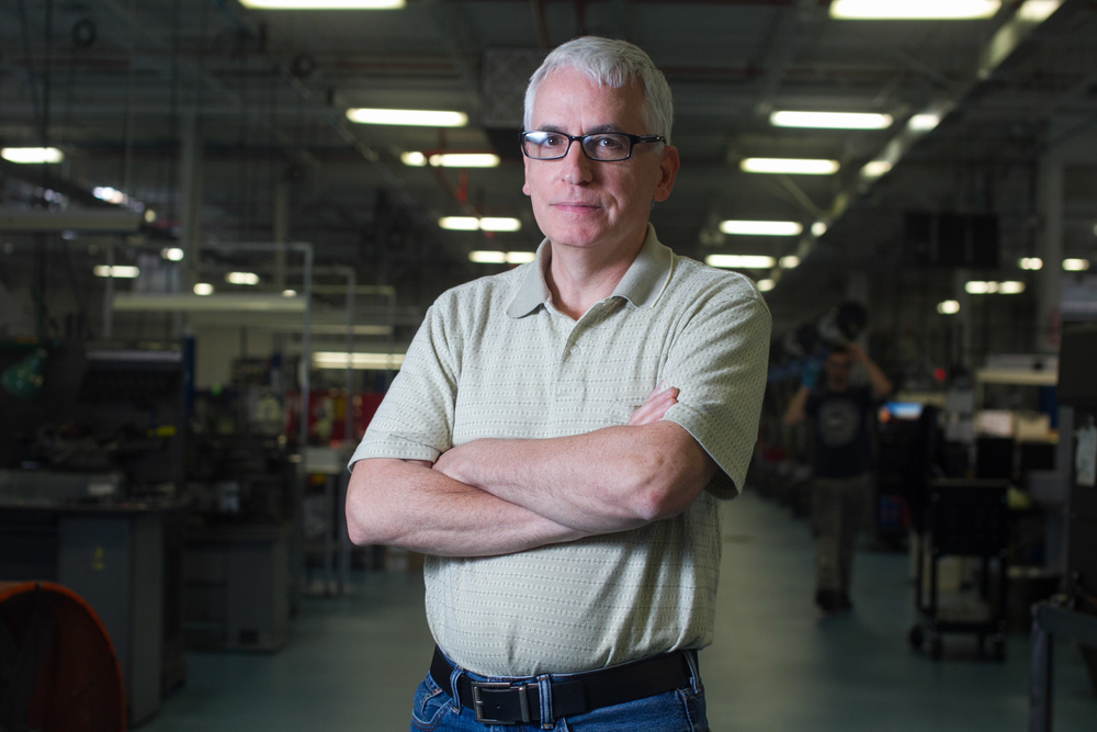 Kenneth Mandile, President of Swissturn/USA poses for a photo on the manufacturing floor of his business in Oxford, Massachusetts on June 17, 2015. Matthew Healey for The Boston Globe
