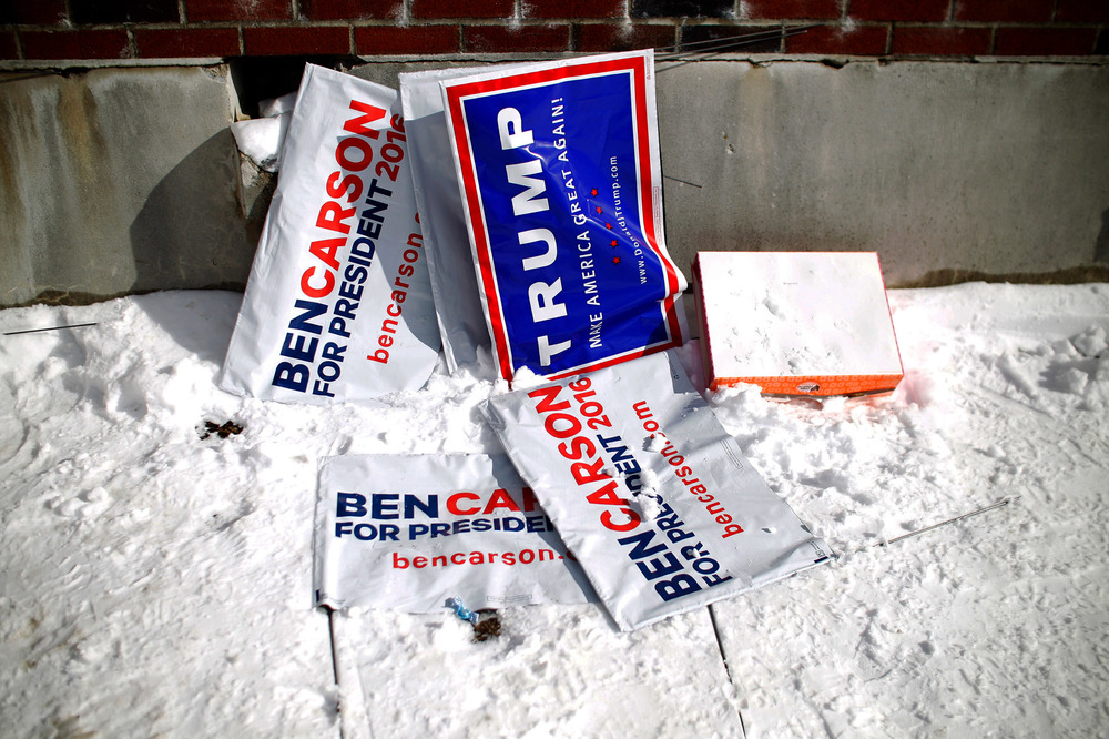 Campaign lawn signs and an empty donut box litter the front entrance of the presidential primary polling station at the Webster Elementary School in Manchester, New Hampshire on February 9, 2016. The New Hampshire presidential primary is the first in the nation and is the culmination of months of campaigning by a large field of Presidential candidates.