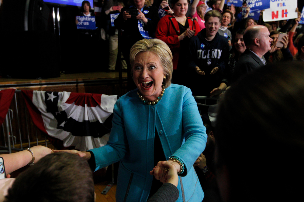 Democratic presidential candidate, Hillary Clinton, shakes hands with members of the audience as she heads to the stage for a Get Out The Vote rally at Alvirne High School in Hudson, New Hampshire on February 8, 2016. The event is Hillary Clinton's final pitch to potential voters before the New Hampshire Primary on Tuesday.