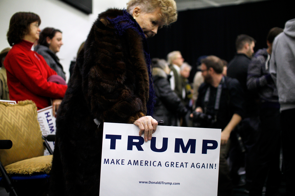 A supporter of Republican candidate for President Donald Trump awaits the candidate arrival at a rally at Plymouth State University in Holderness, New Hampshire on February 7, 2016. New Hampshire will hold the first primary in the nation on February 9th.