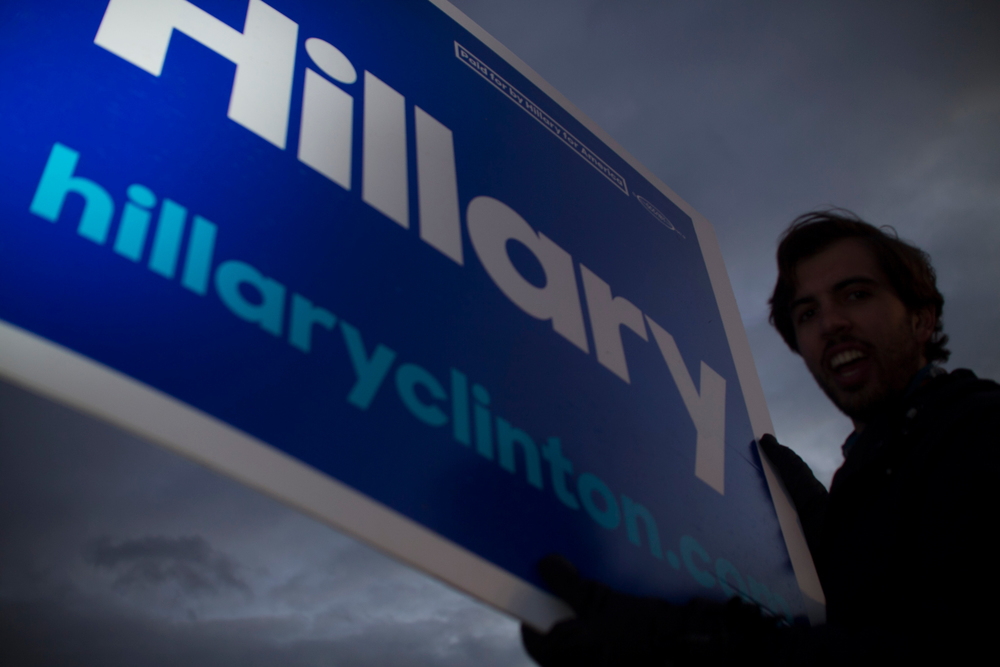 A man chants to show his support for Democratic candidate for president Hillary Clinton, prior to a Democratic candidates debate at St. Anselm College in Manchester, New Hampshire on December 19, 2015. This will be the third Democratic debate.