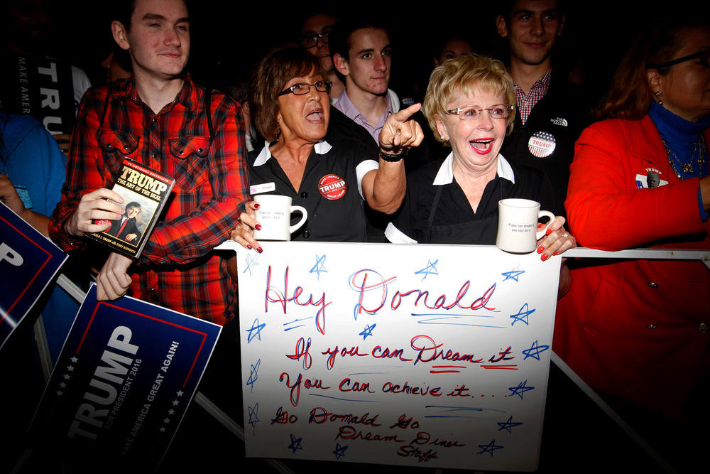 Doreen McGloughlin (2nd-L) and Bridget Trepsas (R) waitresses at the Dream Diner in Tyngsboro, Massachusetts await for the arrival of Republican presidential candidate Donald Trump at a campaign rally  at Tyngsboro Elementary School in Tyngsboro, Massachusetts on October 16, 2015.