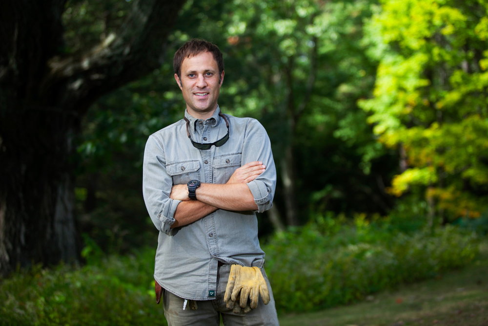 Jason Hill, Superintendent for the north central region management unit for the Trustees of Reservations, poses for a photo in the pinetum of the Farandnear Reservation in Shirley, Massachusetts on September 25, 2015.
