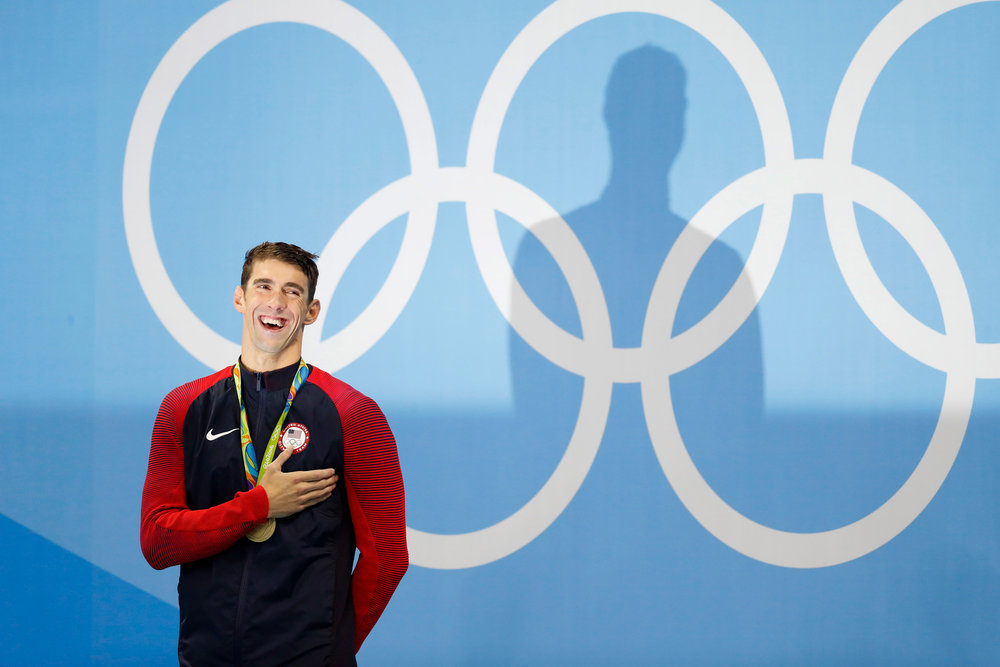 Michael Phelps of the United States stands for the National Anthem after winning a gold medal in the Men's 200m butterfly with a time of 1:53.36 at the Olympic Aquatics Stadium at the 2016 Rio Summer Olympics in Rio de Janeiro, Brazil, on August 9, 2016. Phelps wins his 20th career gold medal.