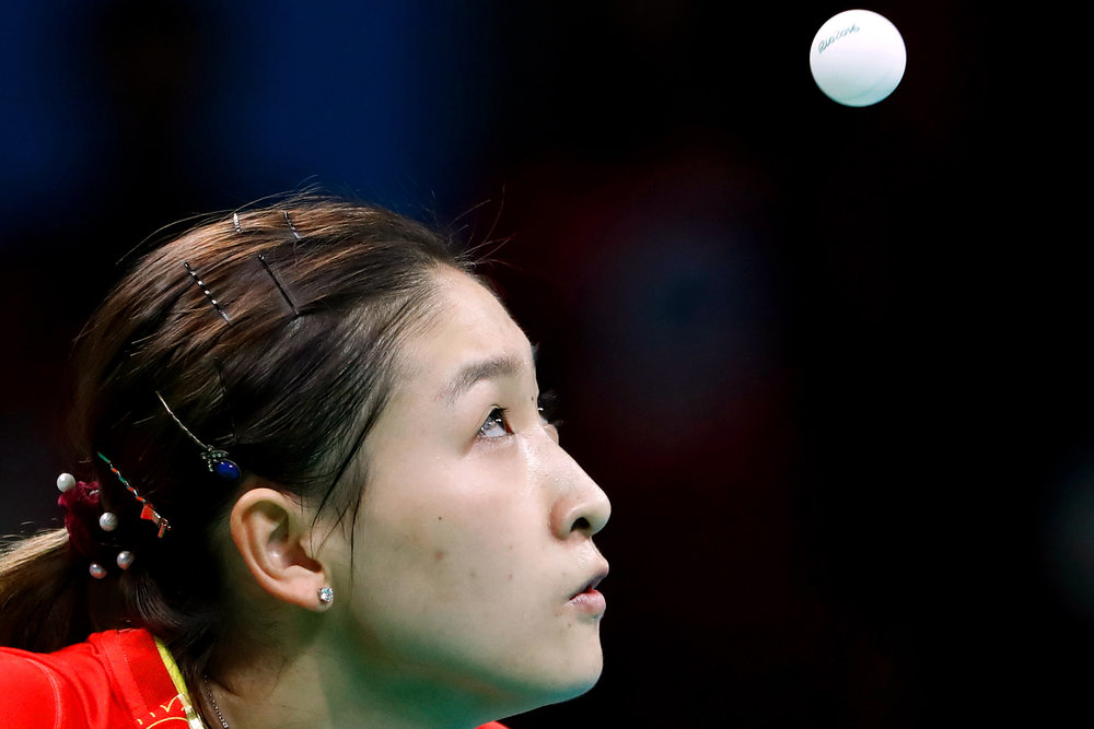 China's Shiwen Liu lines up a serve against Germany's Petrissa Solja in the Women's Team Table Tennis gold medal match in Riocentro Pavilion 3 at the 2016 Rio Summer Olympics in Rio de Janeiro, Brazil, on August 16, 2016.