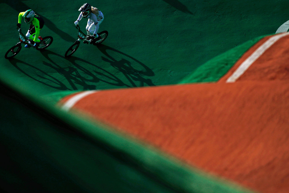 Brazil's Priscilla Carnaval (L) and Germany's Nadja Pries take a corner in a Women's BMX Cycling semifinal in the Olympic BMX Centre at the 2016 Rio Summer Olympics in Rio de Janeiro, Brazil, on August 19, 2016.