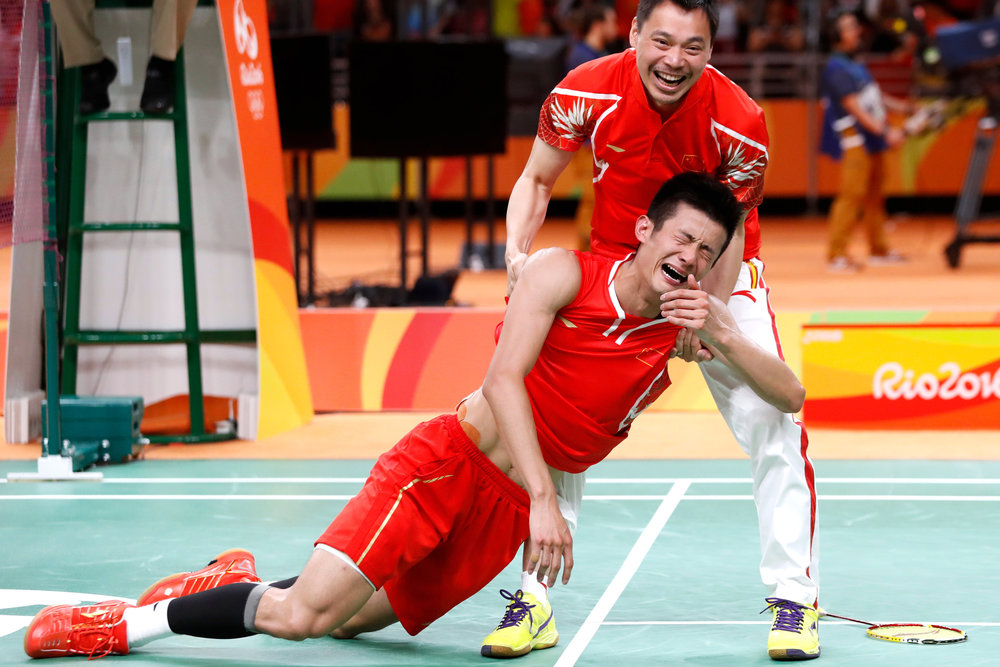 China's Long Chen is picked up by his coach after defeating Malaysia's Chong Wai Lee to win the gold medal in Men's Badminton Singles at the 2016 Rio Summer Olympics in Rio de Janeiro, Brazil, on August 20, 2016.