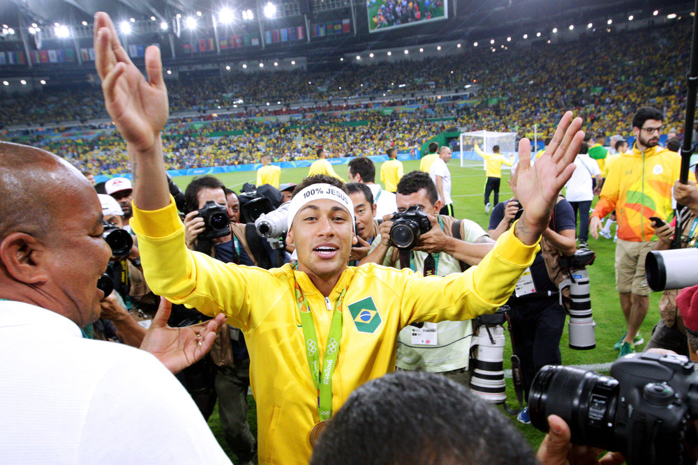 Brazil's midfielder Neymar turns to the crowd after the team defeated Germany in an overtime shoot-out in the Men's Gold Medal soccer match at the 2016 Rio Summer Olympics in Rio de Janeiro, Brazil, on August 20, 2016. Brazil defeated Germany in 5-4 in overtime penalty kicks.