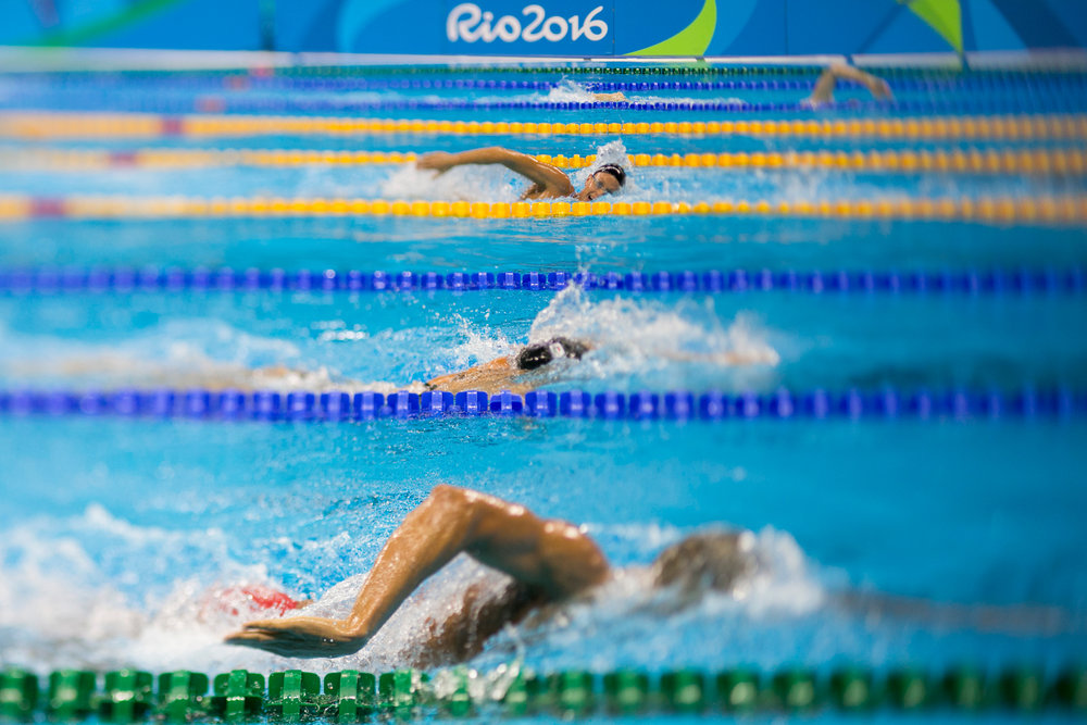 Swimmers take warm-up laps prior to the start of heats at the Olympic Aquatics Stadium at the 2016 Rio Summer Olympics in Rio de Janeiro, Brazil, on August 8, 2016.