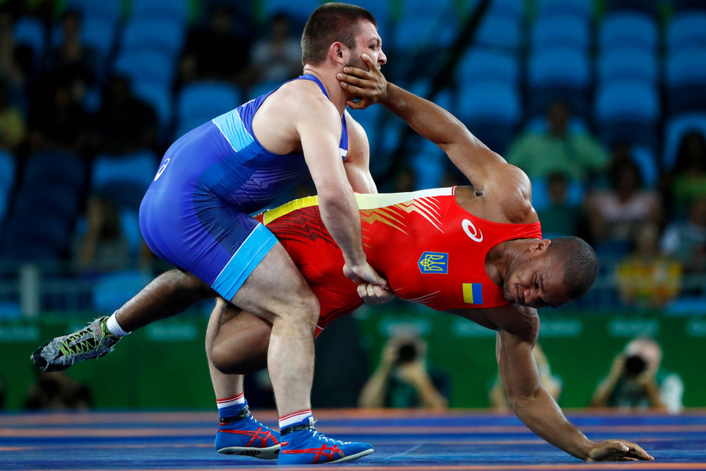 Russia's Davit Chakvetadze (L) grapples with Ukraine's Zhan Beleniuk in the gold medal match of the Men's Greco-Roman 85 kg class inside Arena Carioca 2 at the 2016 Rio Summer Olympics in Rio de Janeiro, Brazil, on August 15, 2016. Chakvetadze defeated Beleniuk to win the gold.