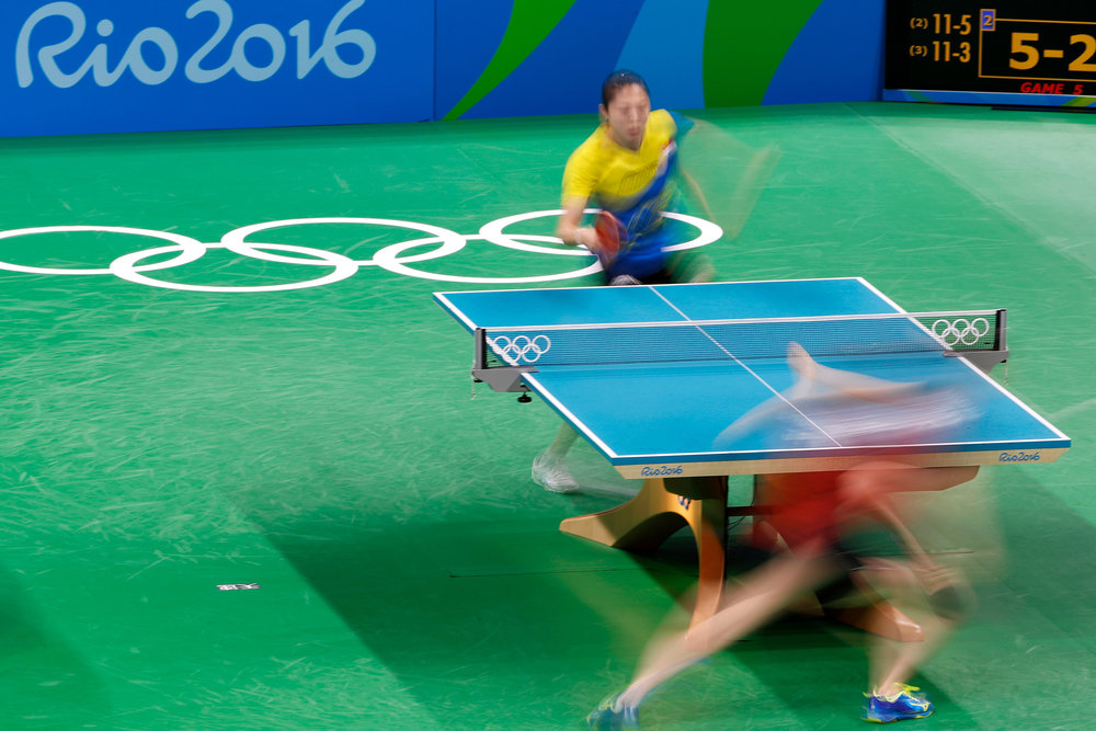 Singapore's Tianwei Feng (TOP) takes on Japan's Kasumi Ishikawa in the Women's Team Table Tennis bronze medal match in Riocentro Pavilion 3 at the 2016 Rio Summer Olympics in Rio de Janeiro, Brazil, on August 16, 2016. Japan clinched the bronze in four matches.