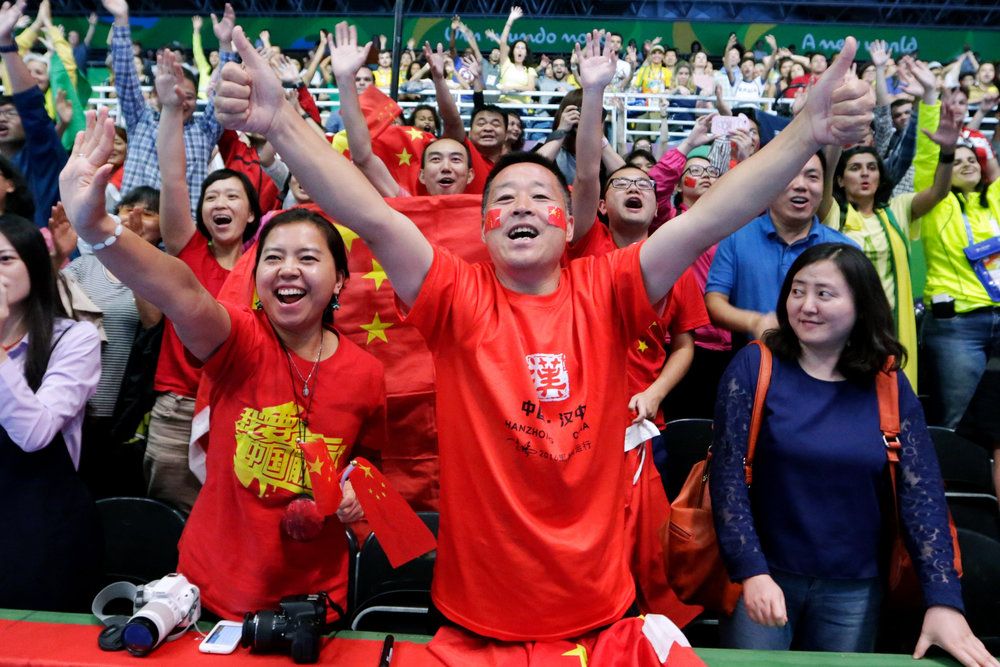 Fans of the Chinese women's table tennis team call out to the players after they defeated Germany in the Women's Team Table Tennis gold medal match in Riocentro Pavilion 3 at the 2016 Rio Summer Olympics in Rio de Janeiro, Brazil, on August 16, 2016. China defeated Germany in three matches to win the gold.