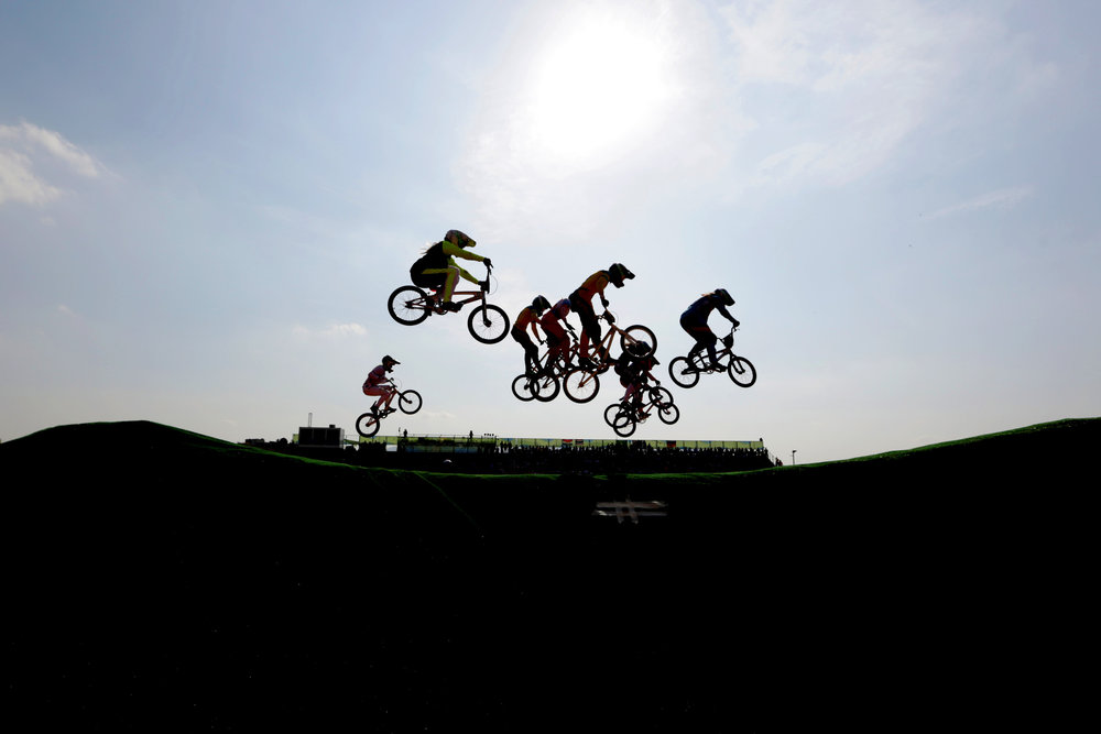 Riders catch some air in the Women's BMX semifinals in the Olympic BMX Centre at the 2016 Rio Summer Olympics in Rio de Janeiro, Brazil, on August 19, 2016.