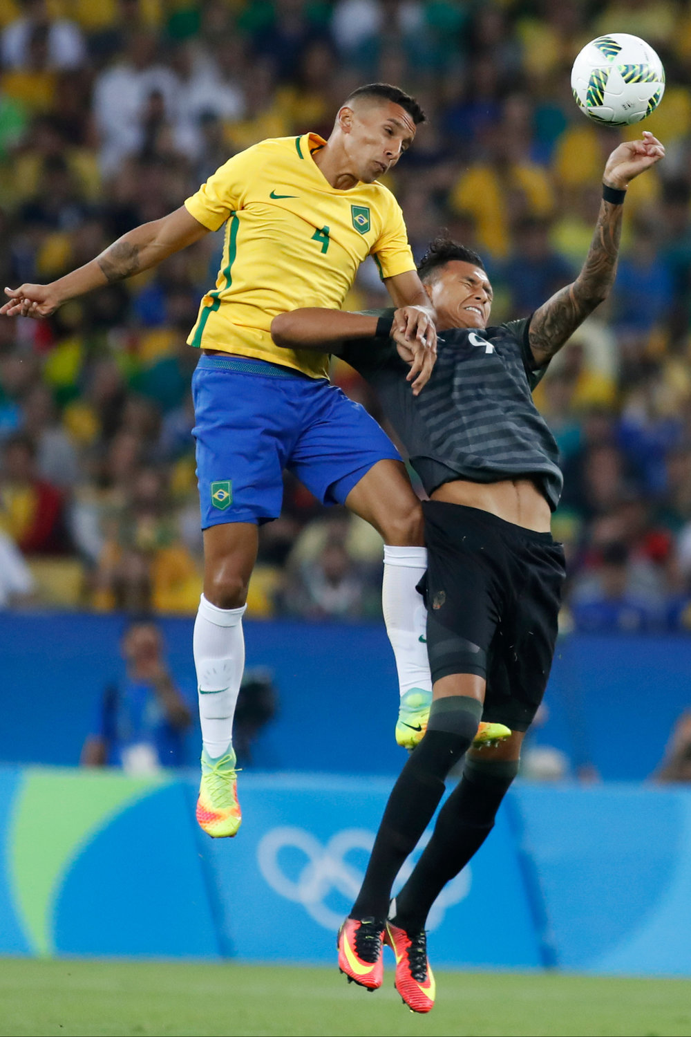Brazil defenseman Marquinhos (4) and Germany forward Davie Selke (9) go for a header in the first half of the Men's Gold Medal soccer match at the 2016 Rio Summer Olympics in Rio de Janeiro, Brazil, on August 20, 2016.