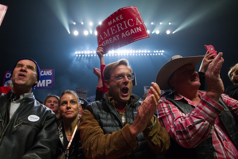 Supporters cheer as Republican vice presidential nominee Mike Pence speaks at a rally for he and presidential nominee Donald Trump at the SNHU Arena in Manchester, New Hampshire on November 7, 2016.