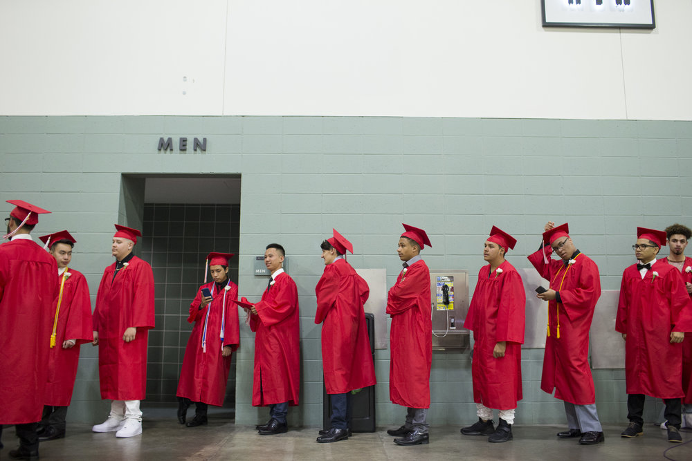 South High Community School graduates line up before the start of the commencement ceremony at the DCU Center in Worcester, Massachusetts on June 7, 2017