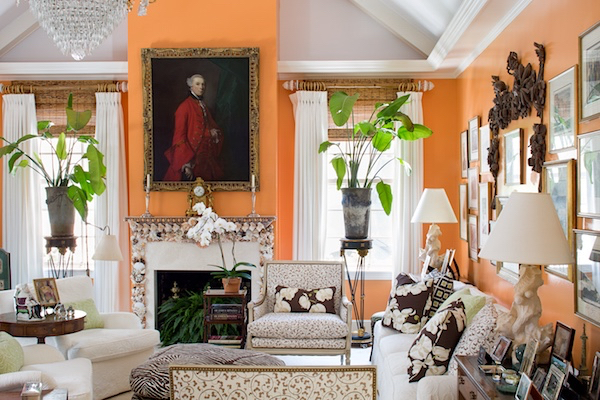 Jean Pearman's Major Alley cottage - designer Mimi Kemble's backdrop of Cantaloupe glazed walls really makes the antiques and artworks in this room pop!