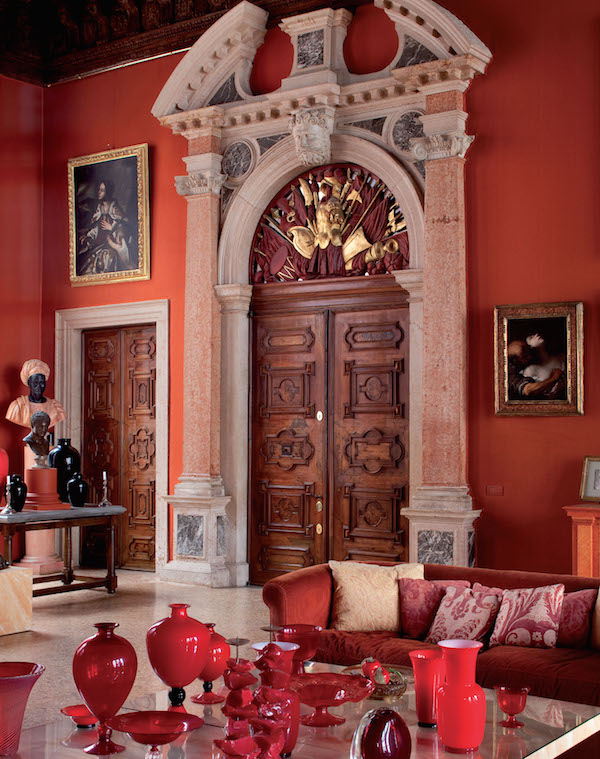 Ca'Corner on the Rio Di San Polo, home of music maestro Pier Luigi Pizzi; a tabletop setting of Italian glassware in various shades of red artfully arranged add a pop to a room rich with dramatic touches
