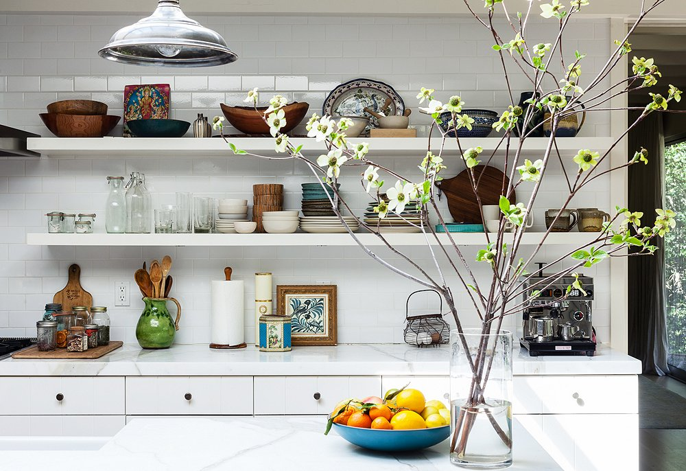 While I like the length of the shelves, there's a little too much stuff on display for my taste; the Calacatta marble used to top the counter and island is one of my favorite stones.
