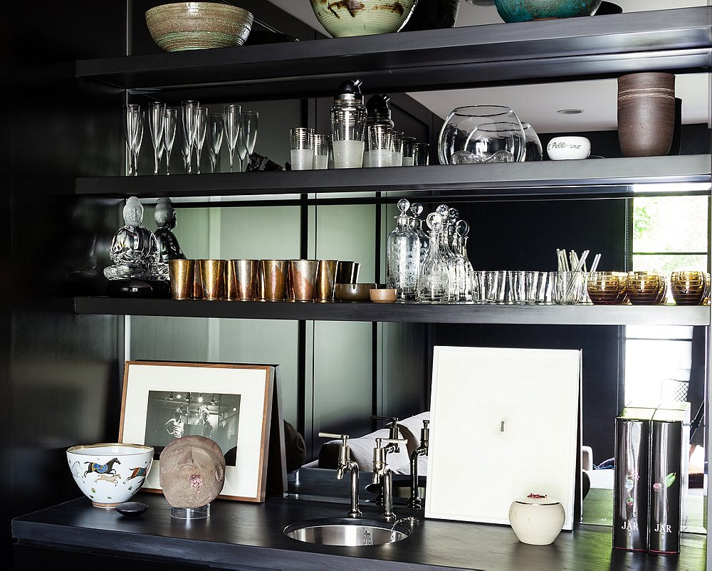 Really like this butler's pantry with mirrored back panel - so cool!