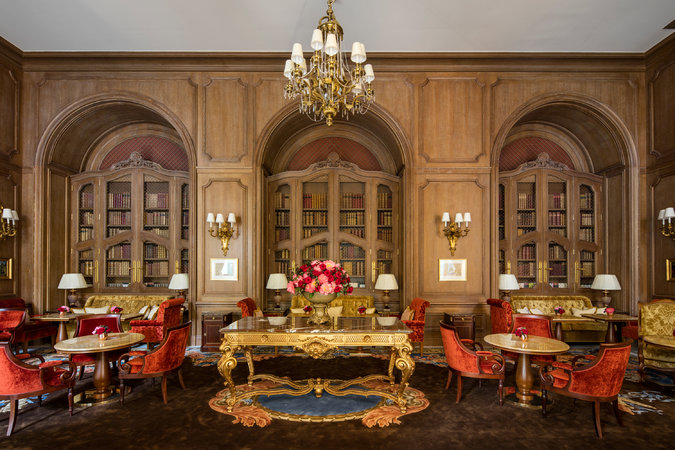 The new Salon Proust -French boiserie (wood panelling) and pops of red make this room cozy and comfortable. A classical French interior at its best