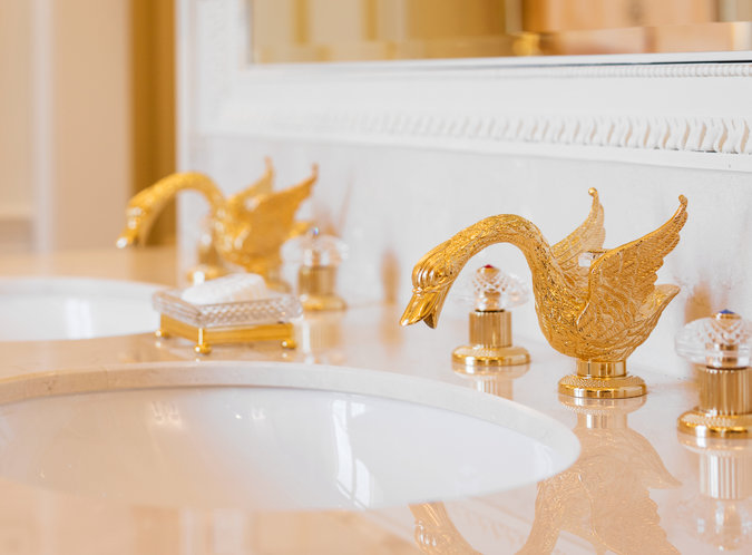 The Ritz signature gold swan faucets - love them!