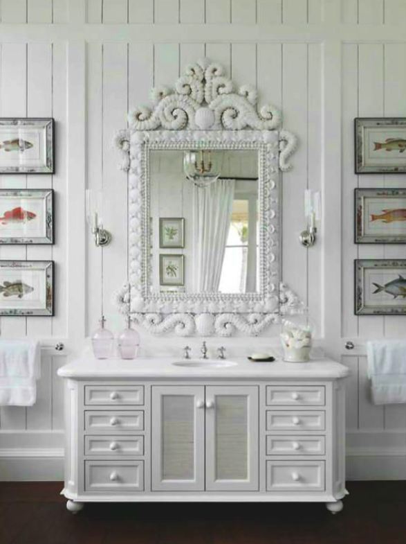 Oversized mirror makes a big statement contrasting nicely with the simplicity of the vanity all in white