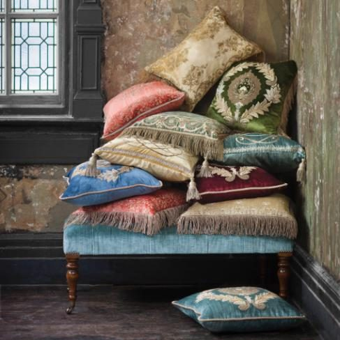 Ornately embroidered cushions by Beaumont & Fletcher