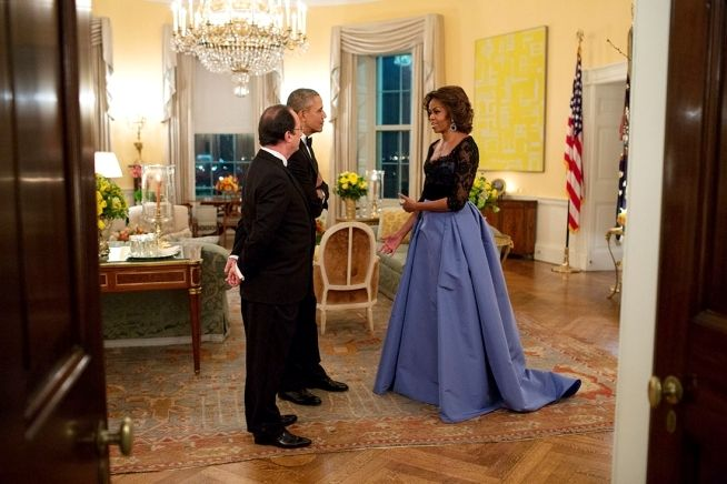 First Lady Michelle strikes a pose in her Carolina Herrera gown, one of her best looks by the way, while chatting with I think Fançois Hollande, President of France in the Yellow Oval Room