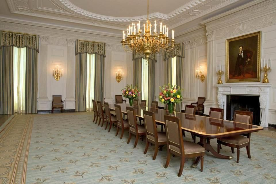 The Obama State Dining Room - both share the same chandelier and white walls...this is a room that would show best when occupied with convivial dining guests