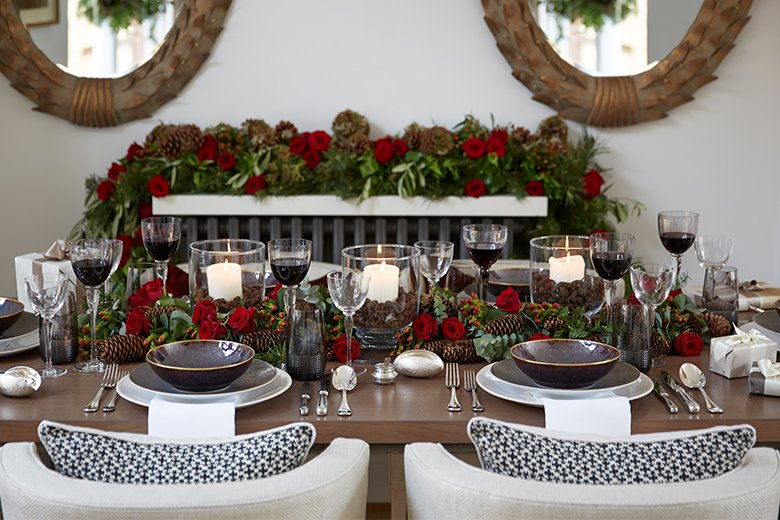 Helen Green Designs uses the timeless color scheme of red florals, brown acorns and green foliage framed in white to great effect