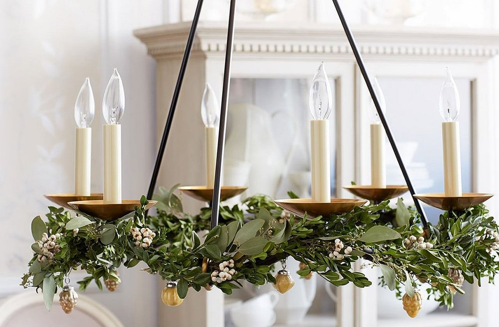 The chandelier gets decorated too...simplicity is key here with ivy and golden acorns sparingly woven throughout