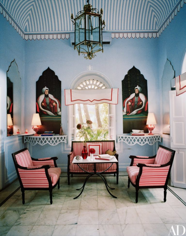 So many details in just this room...painted striped tent ceiling, a pair of mirrors mirror the frames of the pair of portraits...what an interesting effect hanging valances across arched windows