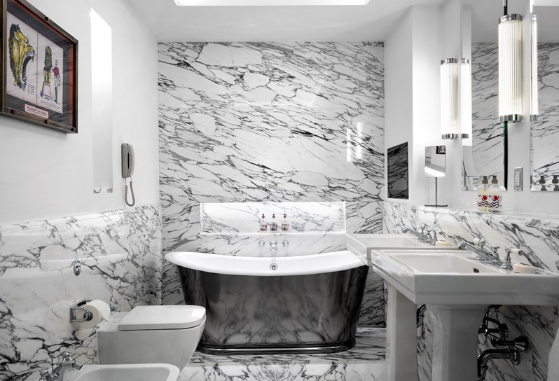 The all-marble bathroom is a Kit Kemp signature and they are just decadently luxurious!