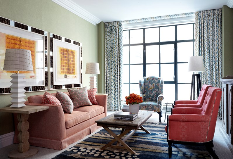A fairly restrained room in terms of color and pattern - the custom-covered rail for the drapes in the same drape fabric is another Kit Kemp signature