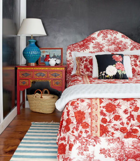 Bjorn Wallander -Countryliving.com... metallic grey walls are the perfect complement to the bold red & white bedlinens, Chinese side table and turquoise lamp