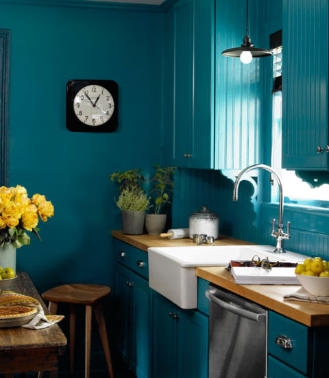 Miki Duisterhof - Countryliving.com... go big or go home by painting walls, cabinetry and trim in the same shade which looks fab in this kitchen